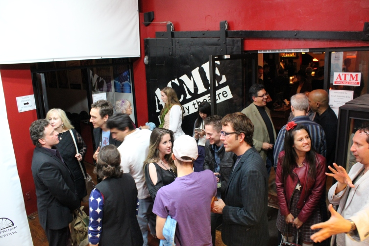 Audience mingling in the lobby of the ACME Theater